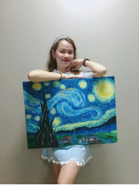 A girl holding Van Gogh's Starry Night painting