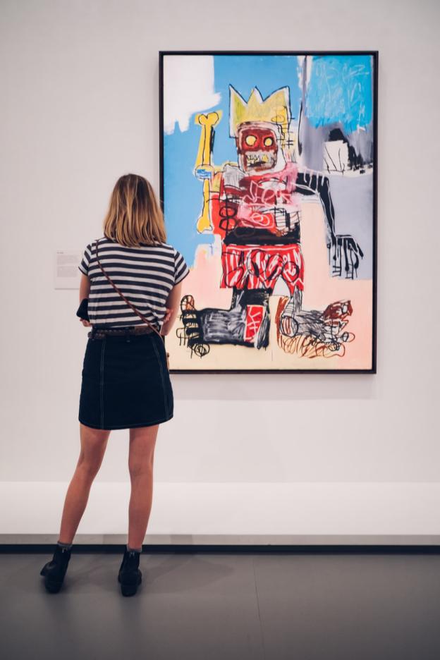 A girl looking at an art piece