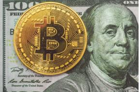 A bitcoin and a US Dollar bill
